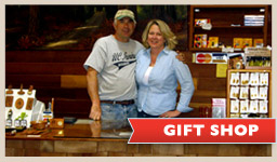 photo of a couple behind gift shop counter